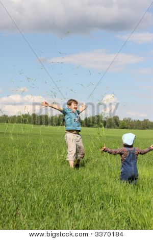 The Boy And The Girl Plays With A Grass