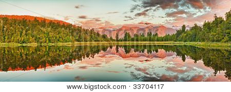 Reflection of the mountains in Matheson lake. Panorama