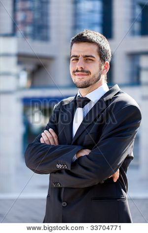 Handsome Business Man Outdoors Next to Office Buildings
