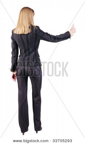 back view of young blonde business woman showing thumb up. beautiful businesswoman in black suit gesturing ok sign. Rear view people collection. backside view of person. Isolated over white background