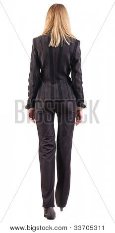 back view of walking business woman.  going young girl in black suit. Rear view people collection.  backside view of person.  Isolated over white background.