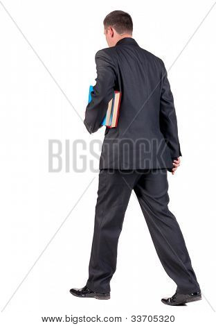 back view of walking  business man with books. going young guy in black suit. Isolated over white background. Rear view people collection. backside view of person