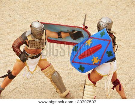 TARRAGONA, SPAIN - MAY 26: Gladiators on the arena of Roman Amphitheater on May 26, 2012 in Tarragona, Spain. Every year, the historic recreation program TarracoViva recreates a gladiators fight
