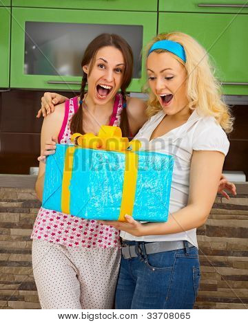 Happy Friends With A Large Gift In The Hands
