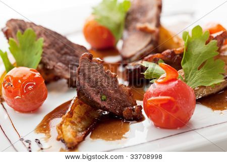 Breast of Duck with Roasted Potato Slice and Cherry Tomatoes