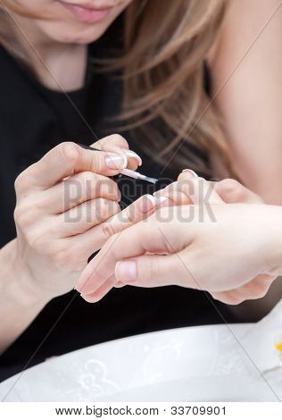Nail polishing during manicure in the salon