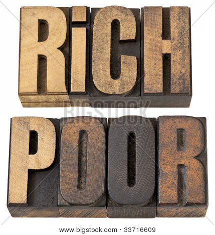 rich and poor - isolated words in vintage letterpress wood type