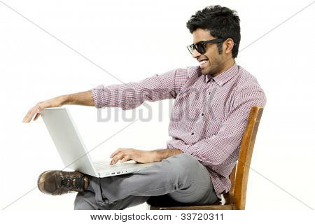 portrait of young man with his laptop