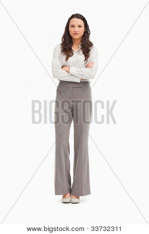 Beautiful employee with folded arms against white background