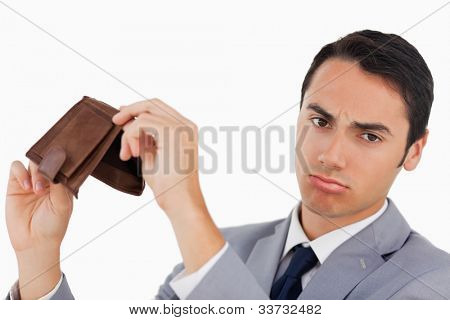 Portrait of a man in a suit with his wallet empty against white background