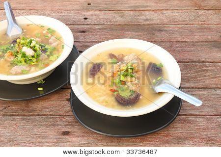 Pork and mushroom congee on morning table.