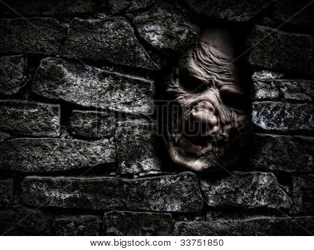 Horror monster looking out from hole in the wall