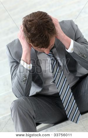 Bankrupted businessman with depressed look on his face