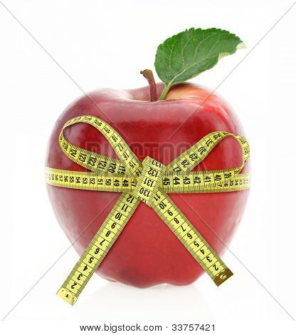 Diet concept. Apple with measuring tape