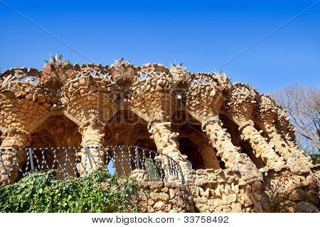 Arcade of masonry stone columns in Park Guell Barcelona of Gaudi modernism