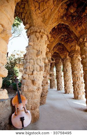 Arcade of masonry stone columns in Park Guell Barcelona of Gaudi modernism