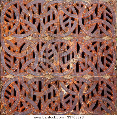 Rusty iron Celtic design storm Grating
