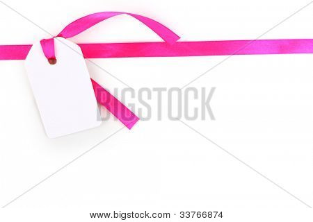 Blank gift tag with pink satin ribbon isolated on white