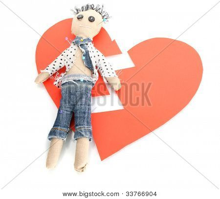 Voodoo doll boy on the broken heart isolated on white