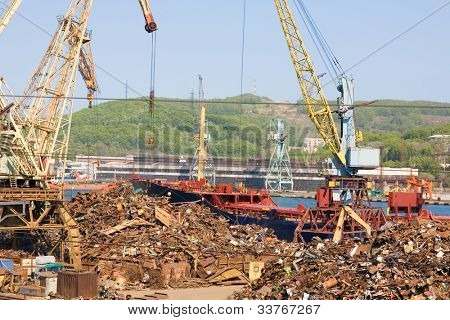 Recycling, loading scrap metal in the ship. Russia. Port of Nakhodka. Primorskiy Kray.