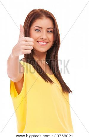 young casual woman giving the ok for something, on white background