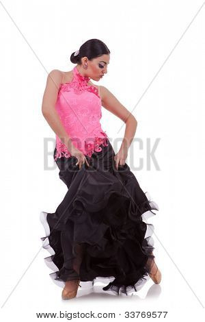 sensual latino dancer pulling up her  dress on white background