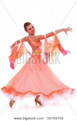 side view of a beautiful woman dancer in a waltz dance move on white background