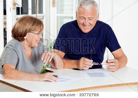 Happy senior couple playing leisure games at home