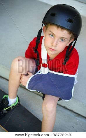 Boy with arm in a sling from a broken humerus