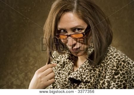 Hispanic Woman With Sunglasses Twists Her Hair