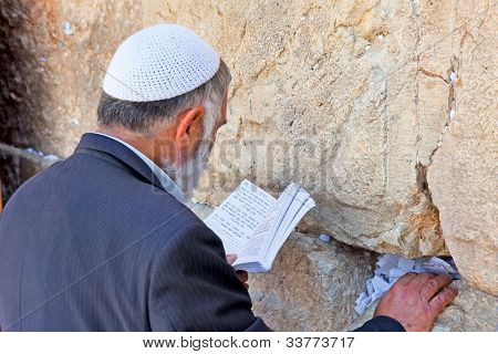 JERUSALEM, ISRAEL - APRIL 26: Jewish sitting and praying at the western wall on a jewish holiday Israel's 64th Independence Day on April 26, 2012 in Jerusalem, Israel