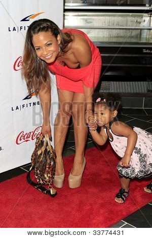 WOODLAND HILLS - JUN 2: Christina Milian, daughter Violet at the Grand Opening Celebrity VIP Reception of the FIRST SIGNATURE LA FITNESS CLUB on June 2, 2012 in Woodland Hills, California