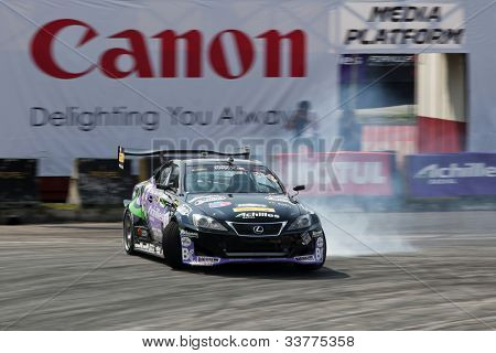 KUALA LUMPUR - MAY 20: Japan's Daito Saito in a Lexus SC430 brake drifts his car leaving a trail of smoke on the tarmac at the Formula Drift 2012 Asia Round 1 on May 20, 2012 in Speedcity, Malaysia.