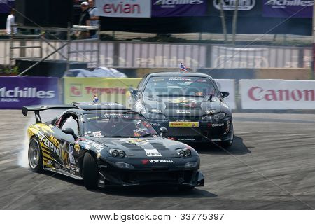 KUALA LUMPUR - MAY 20: Nattawoot (Oat) in a RX-7 car leads his team mate from the M150 Storm Team on a practice run at the Formula Drift 2012 Asia Round 1 on May 20, 2012 in Speedcity, Malaysia.