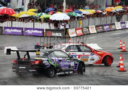 KUALA LUMPUR - MAY 20: Daito Saito (#1) chases Demas Agil (#12) during the Formula Drift 2012 Asia Round 1 on May 20, 2012 in Speedcity, Malaysia. Daito Saito emerged champion in this tournament.