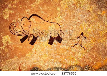 Cave painting of primitive man hunting for mammoth