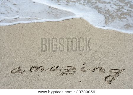 Amazing hand written in the sandy beach