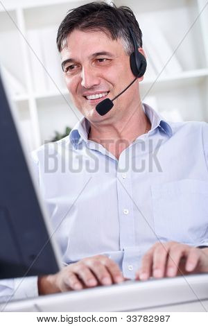 smile busy businesswoman in office place talking on headset in office