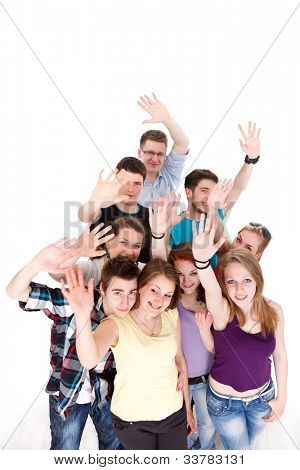 Group of young smiling friends waving their arms on white background