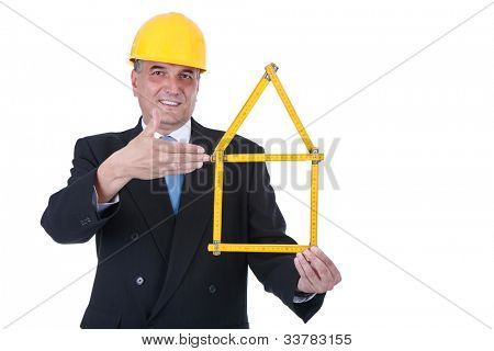 smiling, male architect holding  folding ruler with house shape ,  isolated on white background