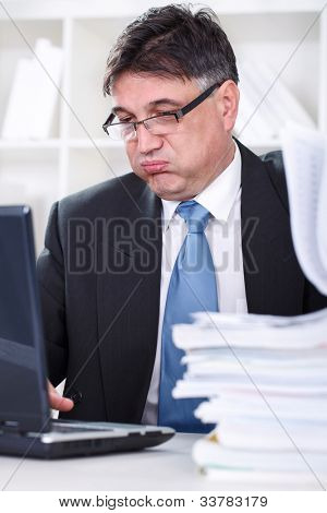 Tired senior Businessman having lot of work
