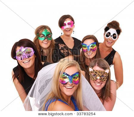 A portrait of seven girlfriends in party moods smiling over white background