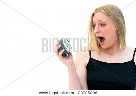 Too late-young beautiful woman holding a clock on a white background