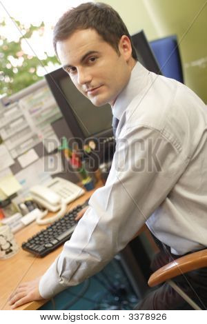 Young Specialist At Workstation