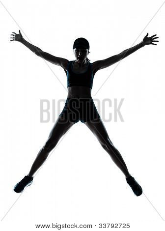 one caucasian woman runner jogger jumping happy jumping in silhouette studio isolated on white background