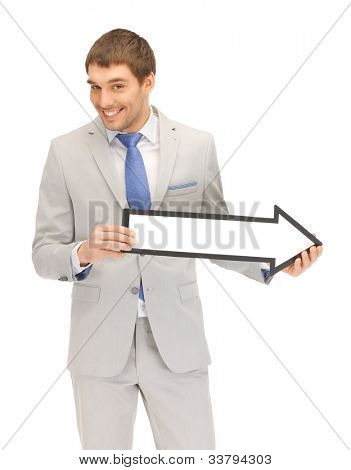 picture of attractive businessman with direction arrow sign