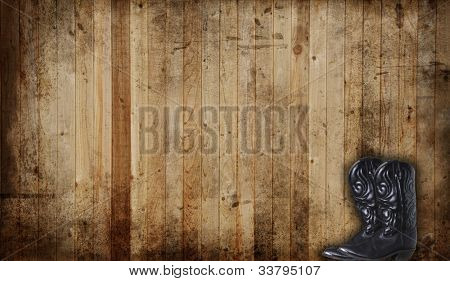 Black Cowboy boots against a weathered cedar background panel.