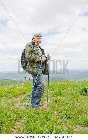 Senior birdwatcher trekking in mountains (Bieszczady, Poland)