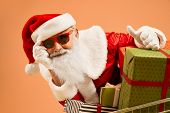 Cool Funny Aged Santa Claus With Grey Beard Wearing Traditional Costume And Red Trendy Sunglasses Sh poster