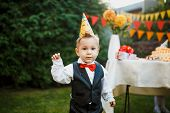 Table Set For Kids Birthday Party Outdoors In Garden And Cute Boy On Birthday Party. Happy Children  poster